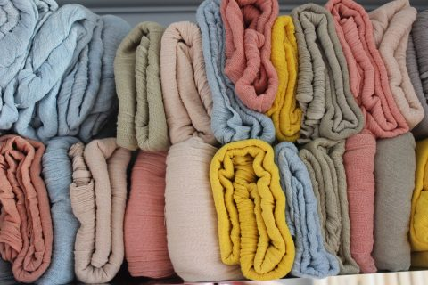 organic cotton scarves hand woven and plant dyed by a co-operative in India.