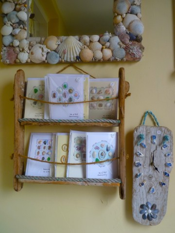 A selection of cards decorated with native Mull flowers or bits and bobs garnered on the seashore for sale.