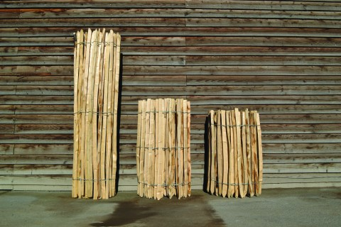 Rolls of pale fencing. Wired chestnut fencing was probably introduced in the early 20th-century.