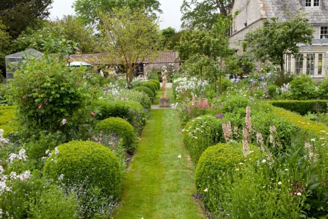 The Old Rectory, Limington, Nr. Yeovil, Somerset.  A romantic walled garden with formal parterres and herbaceous borders.