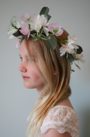 An enchanting wreath adorning a bridesmaid.