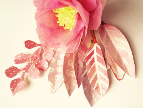 Tissue paper flower and delicately painted card leaves.