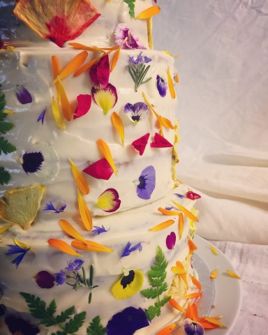 A cake is transformed by adorable edible flowers.